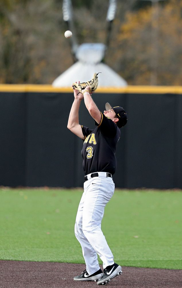 Iowa's Sam Link (3) pulls in a pop up during the second inning of the first game of the Black and Gold Fall World Series at Duane Banks Field in Iowa City on Tuesday, Oct 15, 2019. (Stephen Mally/hawkeyesports.com)