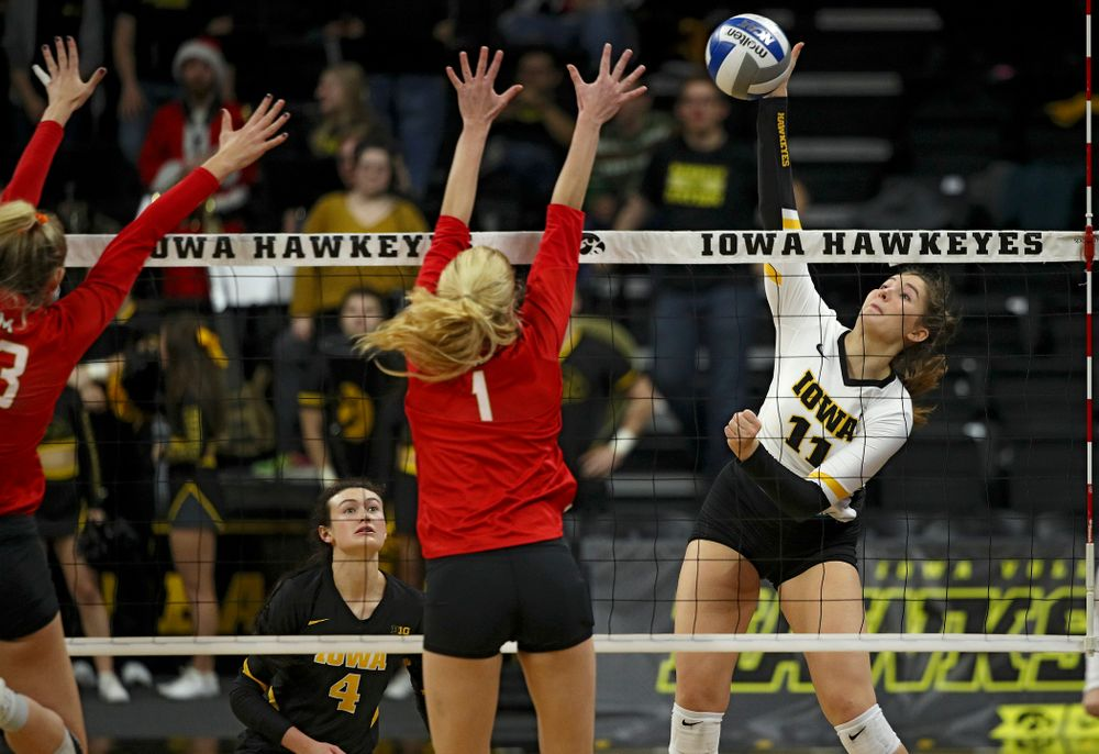 Iowa's Blythe Rients (11) lines up a kill during the fourth set of their match at Carver-Hawkeye Arena in Iowa City on Saturday, Nov 30, 2019. (Stephen Mally/hawkeyesports.com)