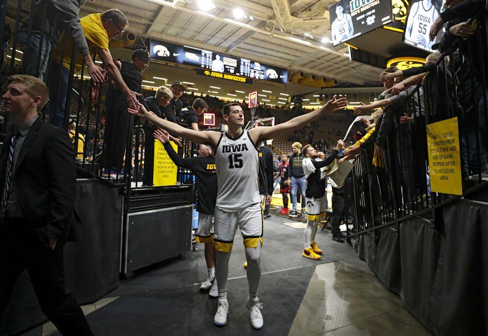 Iowa Hawkeyes forward Ryan Kriener (15) greets fans after winning their game at Carver-Hawkeye Arena in Iowa City on Friday, Nov 8, 2019. (Stephen Mally/hawkeyesports.com)