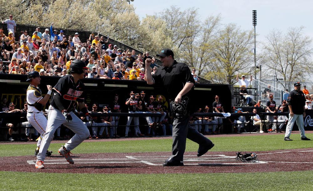 Iowa Hawkeyes catcher Tyler Cropley (5) tags out a runner at home against the Oklahoma State Cowboys Saturday, May 5, 2018 at Duane Banks Field. (Brian Ray/hawkeyesports.com)