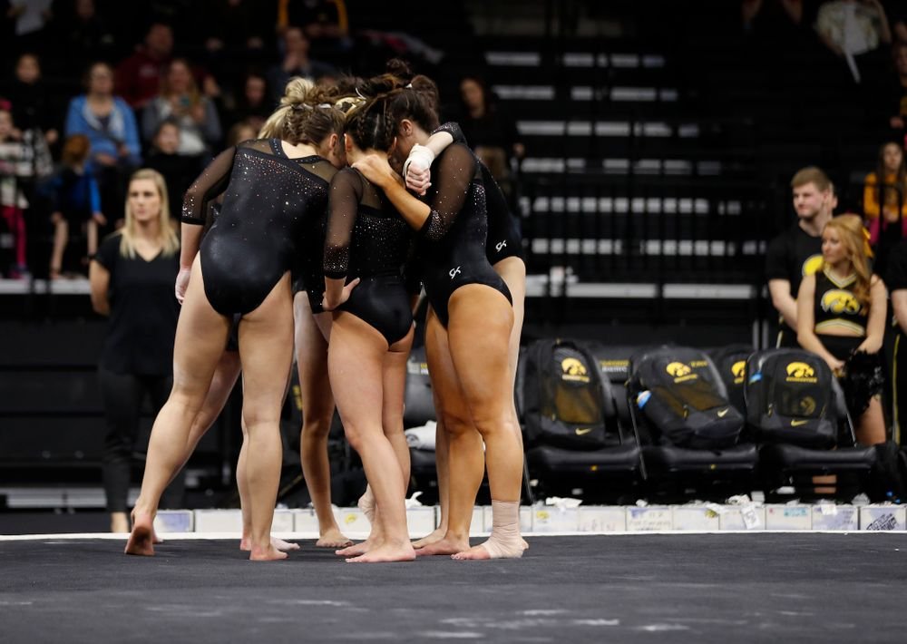 The Iowa Hawkeyes compete on the floor