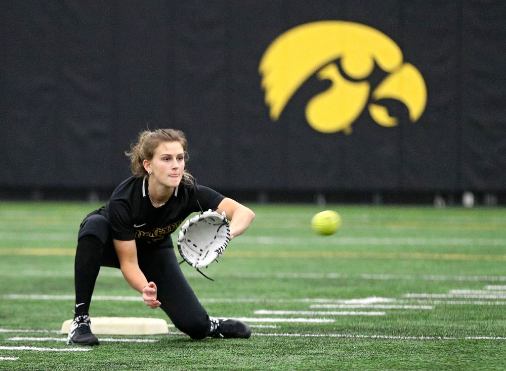 Iowa infielder Mia Ruther (26) pulls in a throw as they run a drill during Iowa Softball Media Day at the Hawkeye Tennis and Recreation Complex in Iowa City on Thursday, January 30, 2020. (Stephen Mally/hawkeyesports.com)