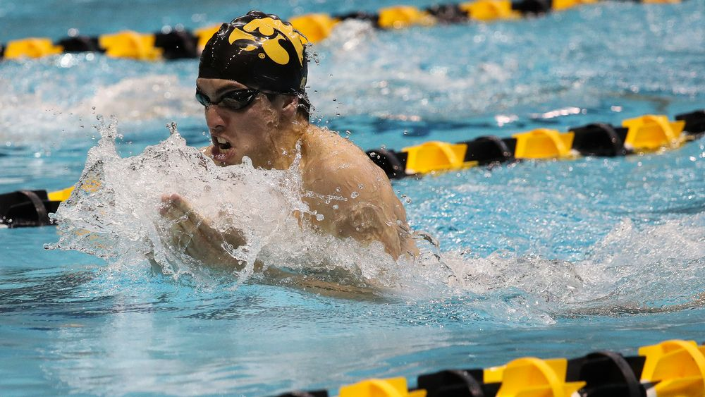 Iowa's Weston Credit competes in the 200-yard breaststroke during a meet against Michigan and Denver at the Campus Recreation and Wellness Center on November 3, 2018. (Tork Mason/hawkeyesports.com)