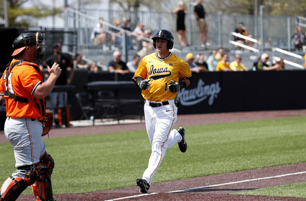 Iowa Hawkeyes infielder Tanner Wetrich (16) scores against the Oklahoma State Cowboys Sunday, May 6, 2018 at Duane Banks Field. (Brian Ray/hawkeyesports.com)