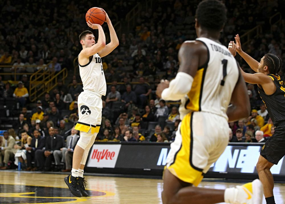 Iowa Hawkeyes guard CJ Fredrick (5) makes a basket during the second half of their their game at Carver-Hawkeye Arena in Iowa City on Sunday, December 29, 2019. (Stephen Mally/hawkeyesports.com)