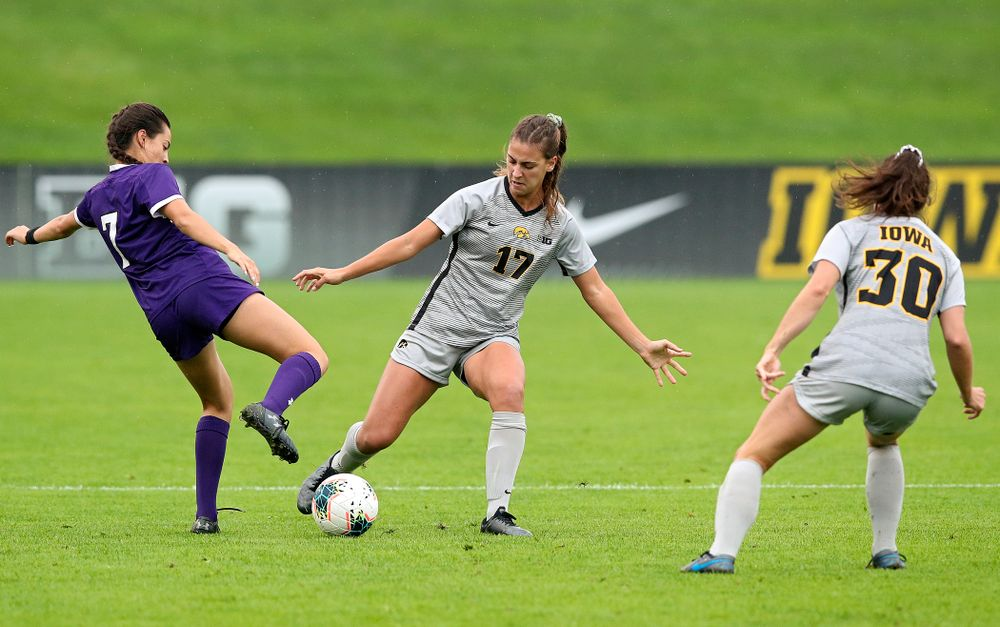 Iowa defender Hannah Drkulec (17) passes the ball as forward Devin Burns (30) looks on during the first half of their match at the Iowa Soccer Complex in Iowa City on Sunday, Sep 29, 2019. (Stephen Mally/hawkeyesports.com)