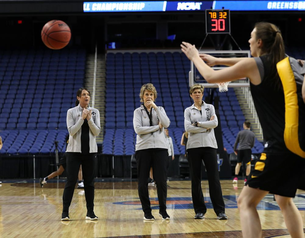 Iowa Hawkeyes head coach Lisa Bluder, associate head coach Jan Jensen, and director of player development Abby Stamp during media and practice as they prepare for their Sweet 16 matchup against NC State Friday, March 29, 2019 at the Greensboro Coliseum in Greensboro, NC.(Brian Ray/hawkeyesports.com)