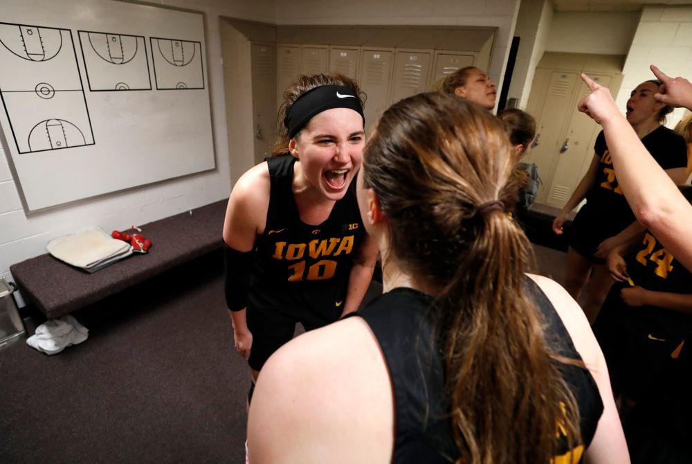 Iowa Hawkeyes forward Megan Gustafson (10) and forward Amanda Ollinger (43)