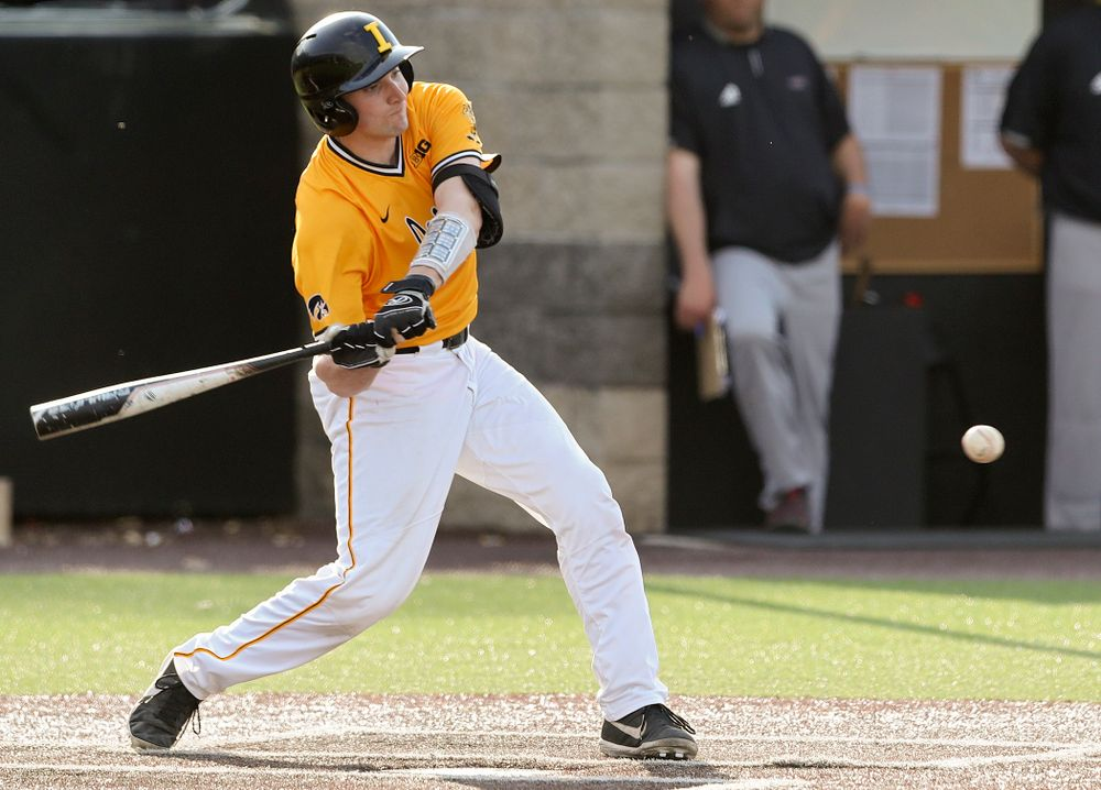 Iowa Hawkeyes catcher Brett McCleary (32) hits a single during the fourth inning of their game against Northern Illinois at Duane Banks Field in Iowa City on Tuesday, Apr. 16, 2019. (Stephen Mally/hawkeyesports.com)