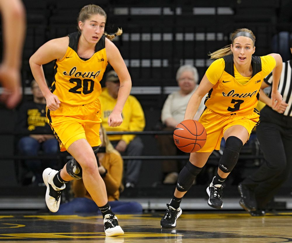 Iowa guard Makenzie Meyer (3) brings the ball down court with guard Kate Martin (20) during the first quarter of their game against Winona State at Carver-Hawkeye Arena in Iowa City on Sunday, Nov 3, 2019. (Stephen Mally/hawkeyesports.com)