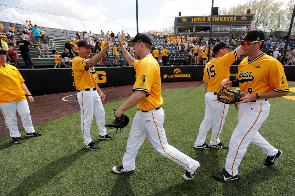 Iowa Hawkeyes outfielder Robert Neustrom (44) and head coach Rick Heller against the Oklahoma State Cowboys Sunday, May 6, 2018 at Duane Banks Field. (Brian Ray/hawkeyesports.com)