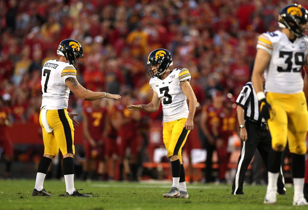 Iowa Hawkeyes place kicker Keith Duncan (3) plays rock, paper, scissors with punter Colten Rastetter (7) following a field goal against the Iowa State Cyclones Saturday, September 14, 2019 in Ames, Iowa. (Brian Ray/hawkeyesports.com)