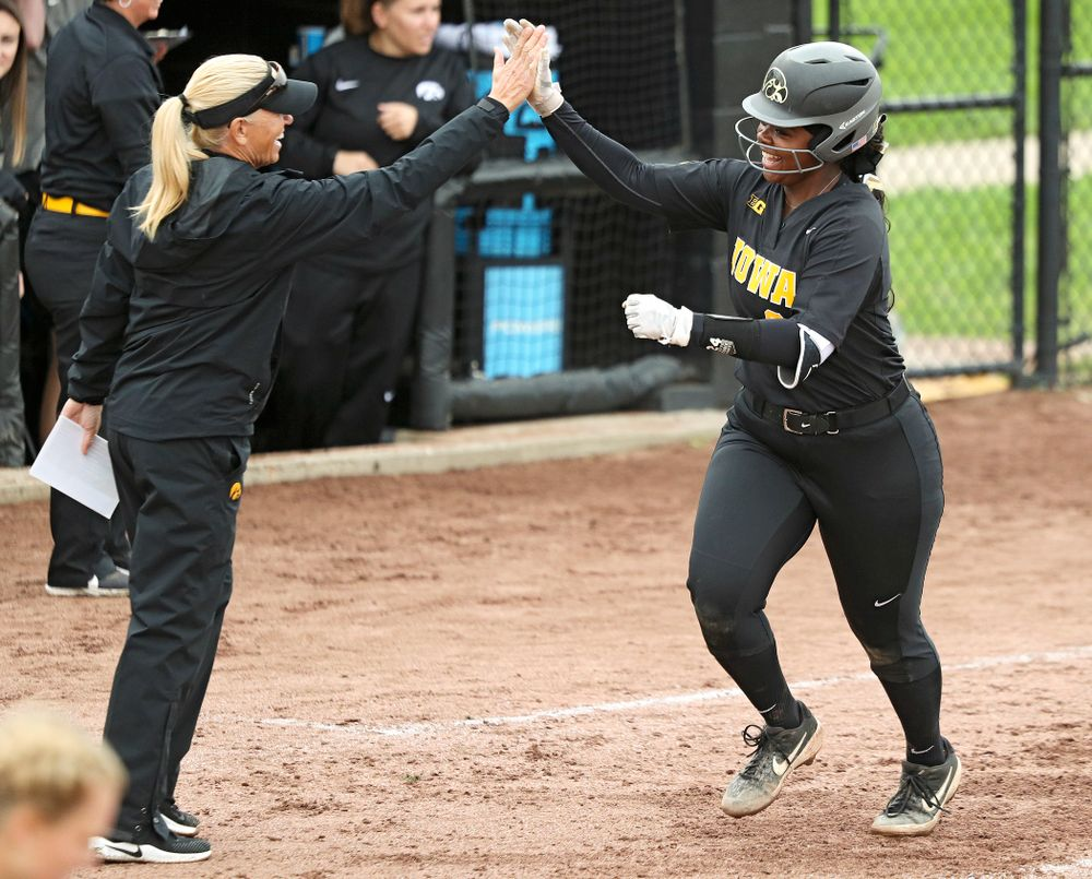 Iowa's DoniRae Mayhew (24) gets a high-five from head coach Renee Gillispie as she rounds the bases after hitting a 3-run home run during the sixth inning of their game against Iowa Softball vs Indian Hills Community College at Pearl Field in Iowa City on Sunday, Oct 6, 2019. (Stephen Mally/hawkeyesports.com)