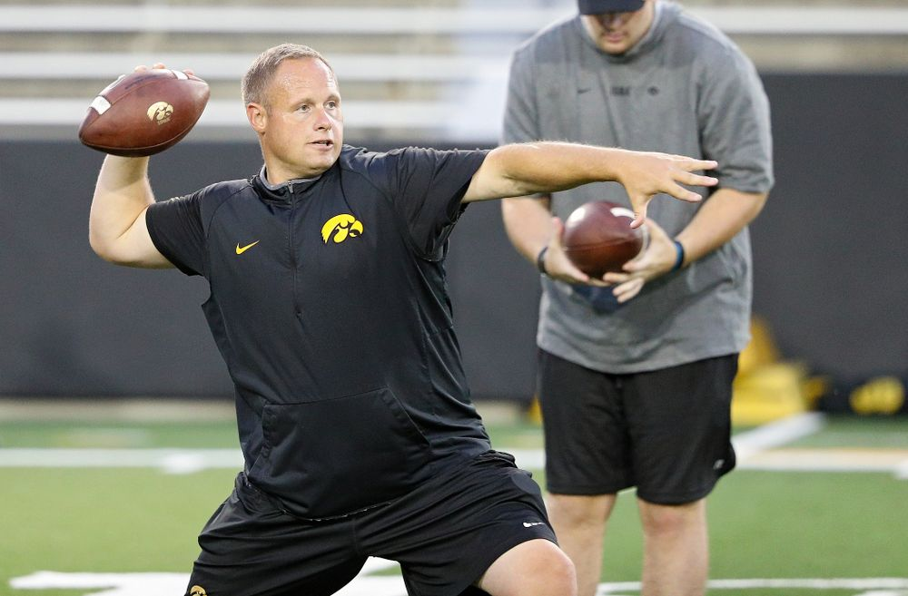 Iowa Hawkeyes linebackers coach Seth Wallace throws a pass during Fall Camp Practice No. 12 at Kinnick Stadium in Iowa City on Thursday, Aug 15, 2019. (Stephen Mally/hawkeyesports.com)