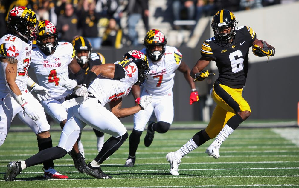 Iowa Hawkeyes wide receiver Ihmir Smith-Marsette (6) runs the ball during a game against Maryland at Kinnick Stadium on October 20, 2018. (Tork Mason/hawkeyesports.com)