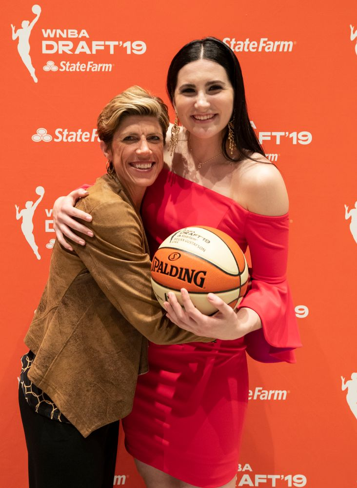 Iowa Hawkeyes forward Megan Gustafson (10) with associate head coach Jan Jensen after being selected by the Dallas Wings in the second round of the 2019 WNBA Draft Wednesday, April 10, 2019 at Nike New York Headquarters in New York City. (Brian Ray/hawkeyesports.com)