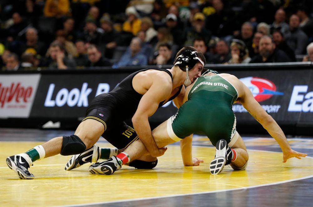 Iowa's Michael Kemerer pins Michigan State's Jake Tucker at 157 pounds