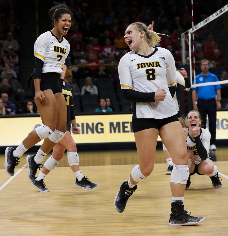 Iowa Hawkeyes setter Brie Orr (7) and Iowa Hawkeyes right side hitter Reghan Coyle (8) celebrate after winning a point during a match against Nebraska at Carver-Hawkeye Arena on November 7, 2018. (Tork Mason/hawkeyesports.com)