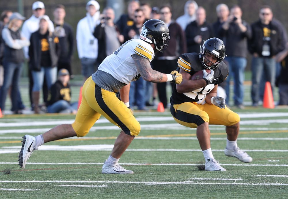 Iowa Hawkeyes running back Toren Young (28) and defensive end A.J. Epenesa (94) during the teamÕs final spring practice Friday, April 26, 2019 at the Kenyon Football Practice Facility. (Brian Ray/hawkeyesports.com)