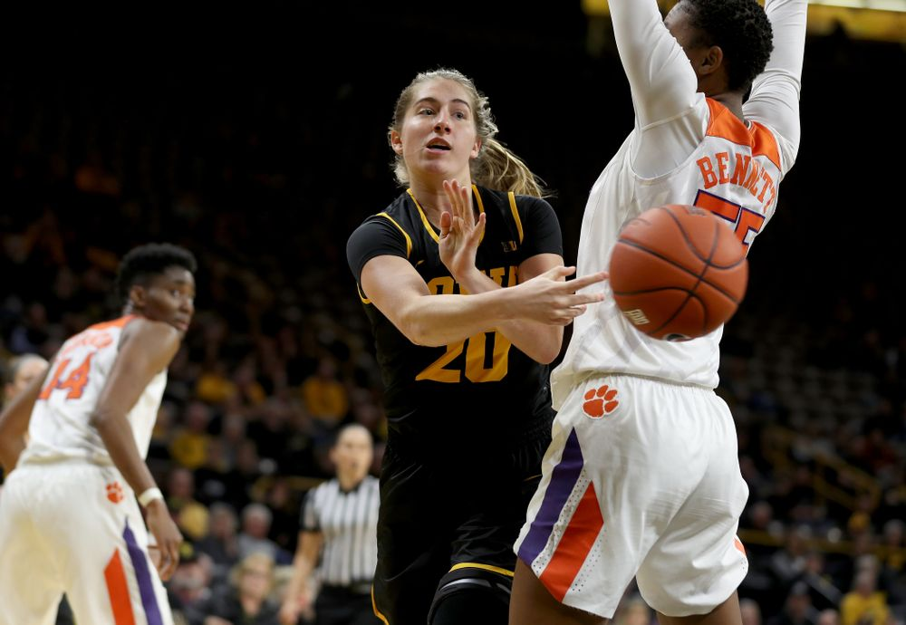 Iowa Hawkeyes guard Kate Martin (20) dishes off a pass against Clemson Wednesday, December 4, 2019 at Carver-Hawkeye Arena. (Brian Ray/hawkeyesports.com)