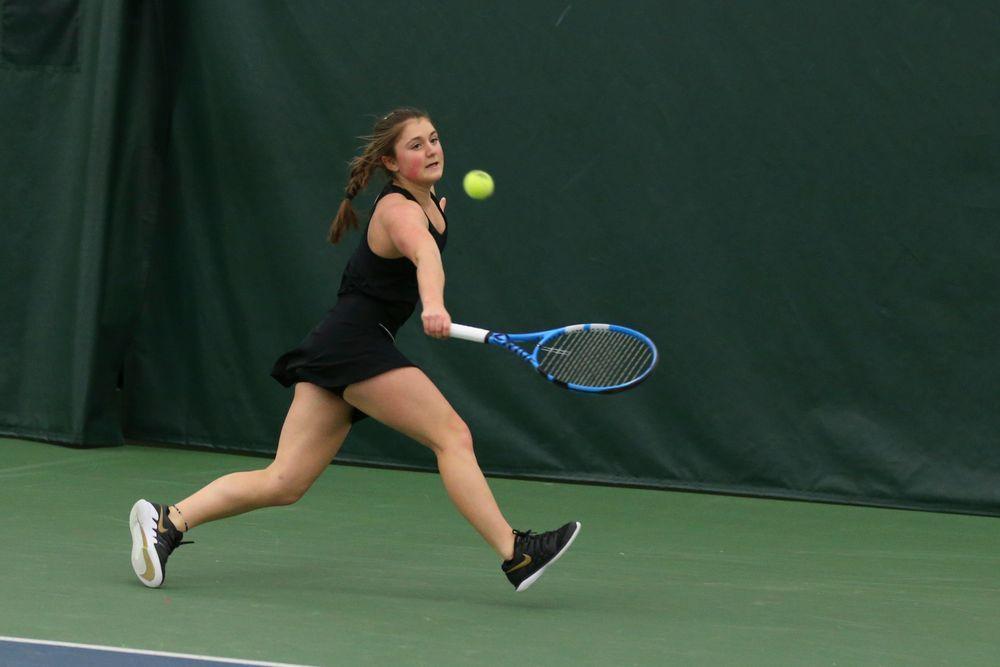 Iowa's Erika Dodridge returns a hit during the Iowa women's tennis meet vs UNI  on Saturday, February 29, 2020 at the Hawkeye Tennis and Recreation Complex. (Lily Smith/hawkeyesports.com)