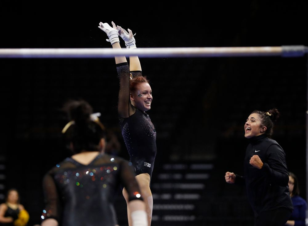 Maria Ortiz competes on the bars