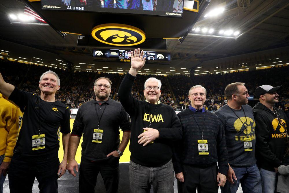 Legendary former head coach Dan Gable shakes hands with Iowa Wrestling alumni  during the Iowa Hawkeyes dual against Oklahoma State Sunday, February 23, 2020 at Carver-Hawkeye Arena. (Brian Ray/hawkeyesports.com)