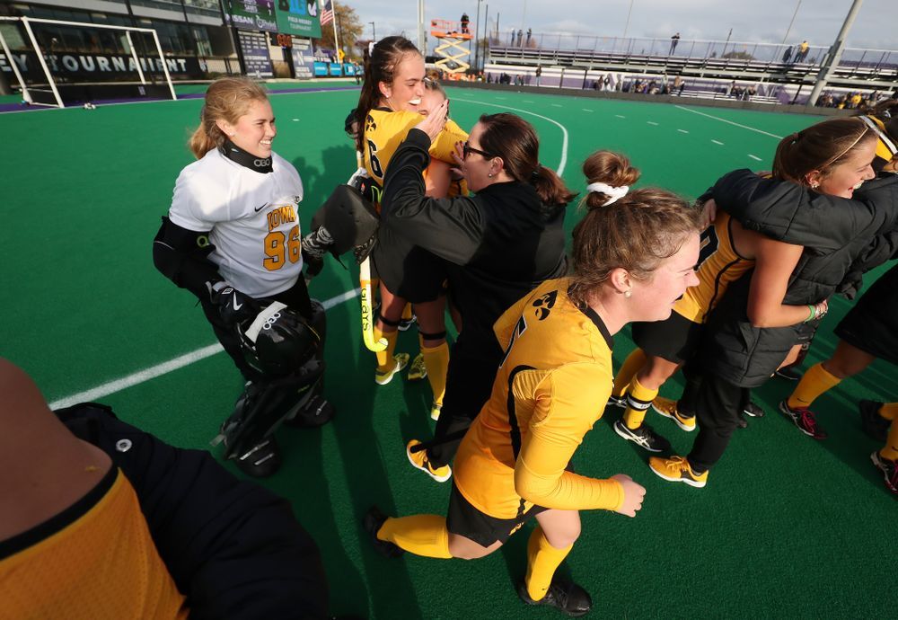Iowa Hawkeyes head coach Lisa Cellucci high fives Leslie Speight (96) following their game against the Michigan Wolverines in the semi-finals of the Big Ten Tournament Friday, November 2, 2018 at Lakeside Field on the campus of Northwestern University in Evanston, Ill. (Brian Ray/hawkeyesports.com)