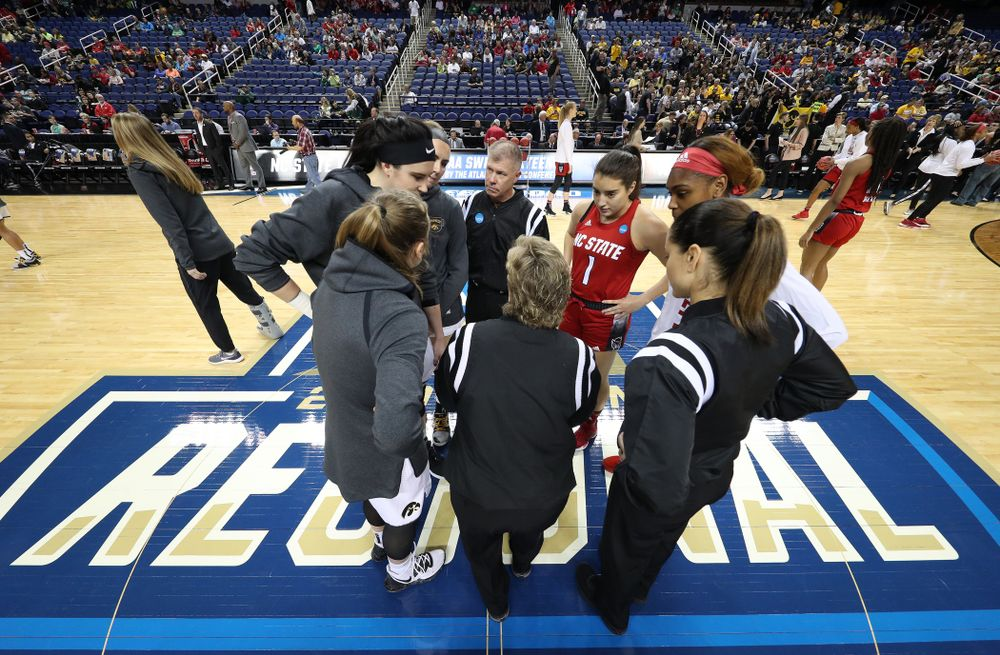 Iowa Hawkeyes guard Kathleen Doyle (22), forward Megan Gustafson (10), and forward Hannah Stewart (21) against the NC State Wolfpack in the regional semi-final of the 2019 NCAA Women's College Basketball Tournament Saturday, March 30, 2019 at Greensboro Coliseum in Greensboro, NC.(Brian Ray/hawkeyesports.com)