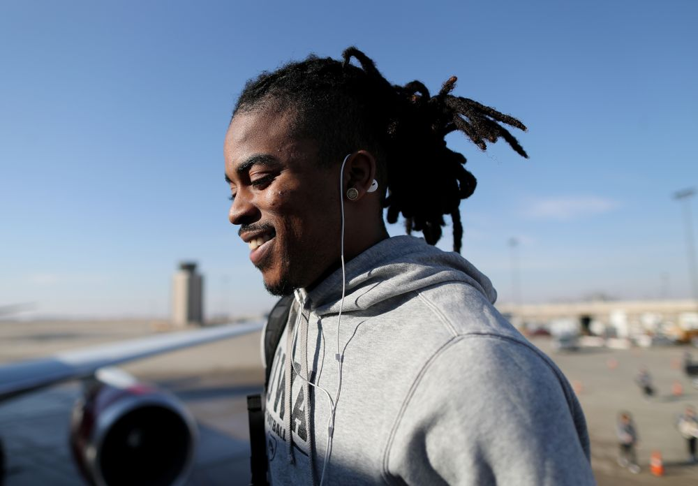 Iowa Hawkeyes defensive back Devonte Young (17) boards the team plane at the Eastern Iowa Airport Saturday, December 21, 2019 on the way to San Diego, CA for the Holiday Bowl. (Brian Ray/hawkeyesports.com)