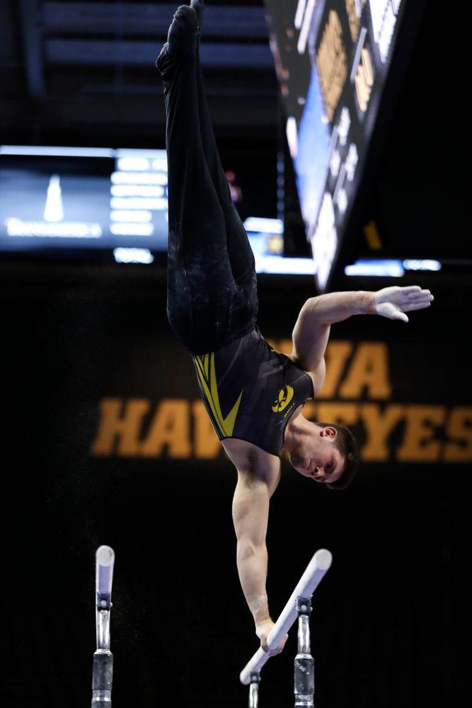 Iowa's Rogelio Vazquez competes on the bars