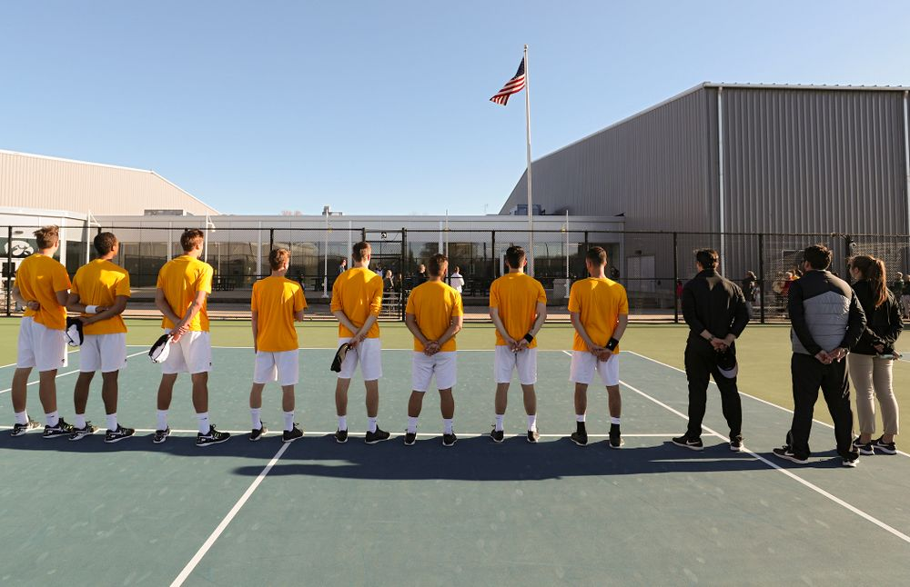 The Iowa Hawkeyes stand for the National Anthem before their match again Michigan State at the Hawkeye Tennis and Recreation Complex in Iowa City on Friday, Apr. 19, 2019. (Stephen Mally/hawkeyesports.com)