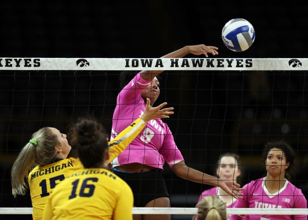 Iowa Hawkeyes middle blocker Amiya Jones (9) against the Michigan Wolverines Friday, October 11, 2019 at Carver-Hawkeye Arena.(Brian Ray/hawkeyesports.com)