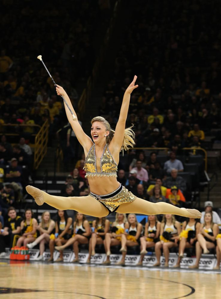 Hawkeye Marching Band Golden Girl ?Kylene Spanbauer performs at halftime of the Iowa Hawkeyes game against the Michigan Wolverines Friday, February 1, 2019 at Carver-Hawkeye Arena. (Brian Ray/hawkeyesports.com)