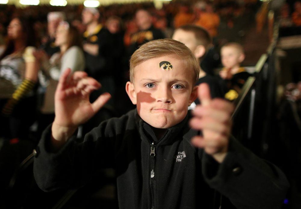 A young fan cheers on the Hawkeyes as they wrestle Nebraska Saturday, January 18, 2020 at Carver-Hawkeye Arena. (Brian Ray/hawkeyesports.com)