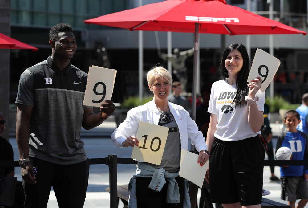 Iowa Hawkeyes forward Megan Gustafson (10) judges dunks with DukeÕs Zion Williamson  during a Special Olympics event Friday, April 12, 2019 as part of the ESPN College Basketball Awards in the XBOX Plaza at LA Live.  (Brian Ray/hawkeyesports.com)