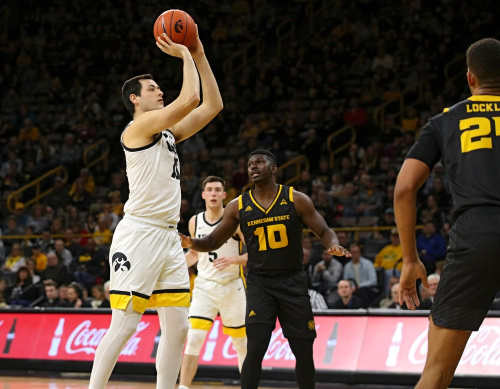 Iowa Hawkeyes forward Ryan Kriener (15) scores a basket during the second half of their their game at Carver-Hawkeye Arena in Iowa City on Sunday, December 29, 2019. (Stephen Mally/hawkeyesports.com)