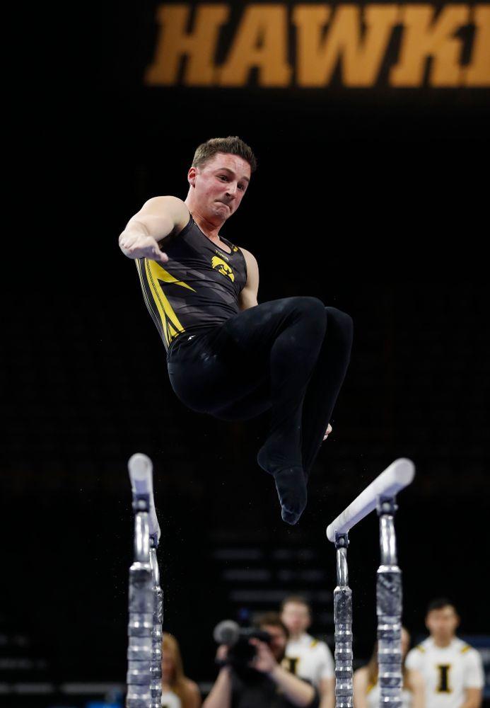 Iowa's Jake Brodarzon competes on the bars