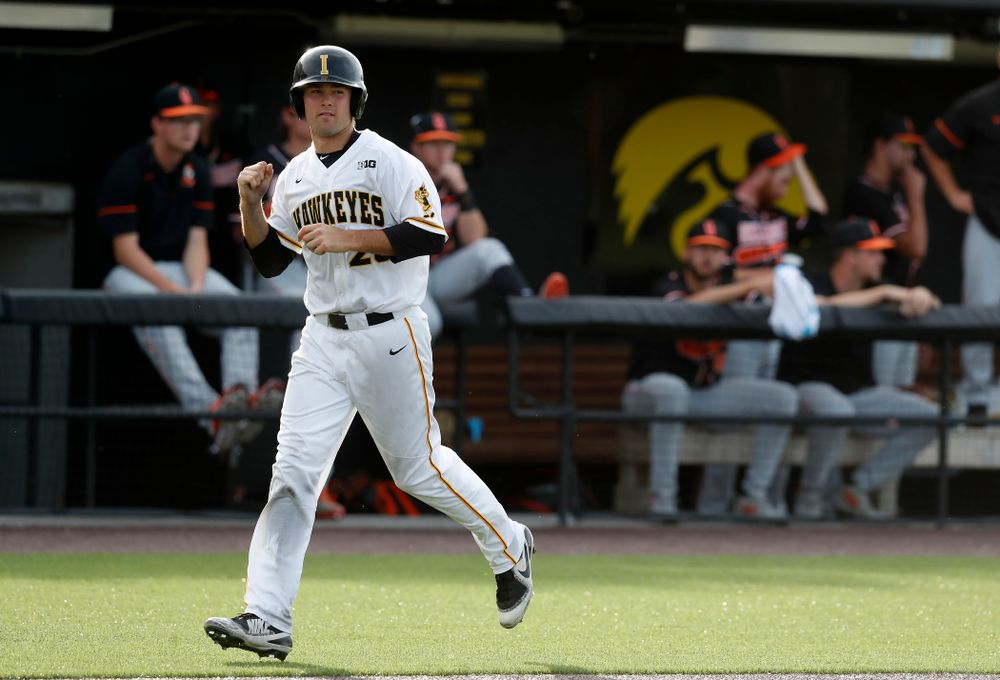 Iowa Hawkeyes infielder Kyle Crowl (23) scores against the Oklahoma State Cowboys Saturday, May 5, 2018 at Duane Banks Field. (Brian Ray/hawkeyesports.com)