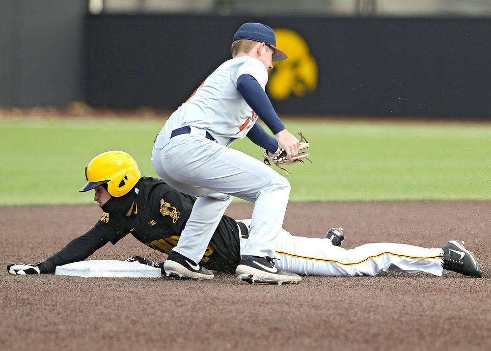Iowa Hawkeyes shortstop Tanner Wetrich (16) steals second base during the sixth inning of their game against Illinois at Duane Banks Field in Iowa City on Saturday, Mar. 30, 2019. (Stephen Mally/hawkeyesports.com)