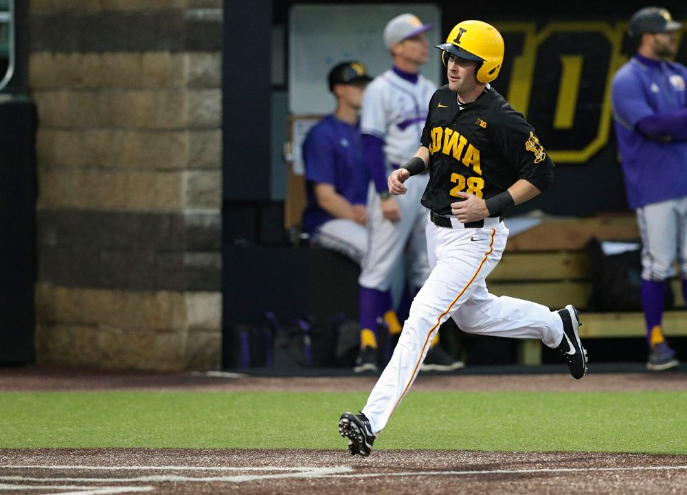 Iowa Hawkeyes left fielder Chris Whelan (28) scores a run during the fourth inning of their game against Western Illinois at Duane Banks Field in Iowa City on Wednesday, May. 1, 2019. (Stephen Mally/hawkeyesports.com)