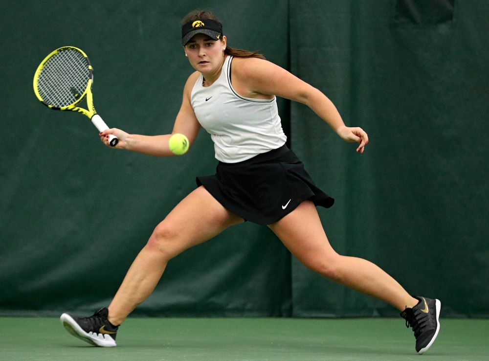 Iowa's Danielle Bauers chases down a shot during her singles match at the Hawkeye Tennis and Recreation Complex in Iowa City on Sunday, February 16, 2020. (Stephen Mally/hawkeyesports.com)