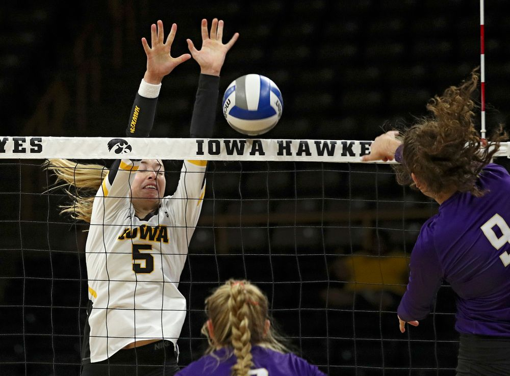 Iowa's Meghan Buzzerio (5) blocks a shot for a score during their Big Ten/Pac-12 Challenge match at Carver-Hawkeye Arena in Iowa City on Saturday, Sep 7, 2019. (Stephen Mally/hawkeyesports.com)