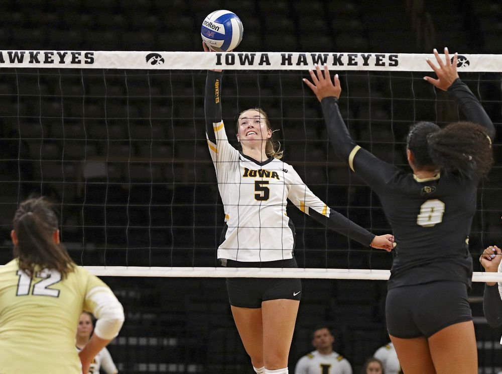 Iowa's Meghan Buzzerio (5) tips the ball over the net during the third set of their Big Ten/Pac-12 Challenge match against Colorado at Carver-Hawkeye Arena in Iowa City on Friday, Sep 6, 2019. (Stephen Mally/hawkeyesports.com)