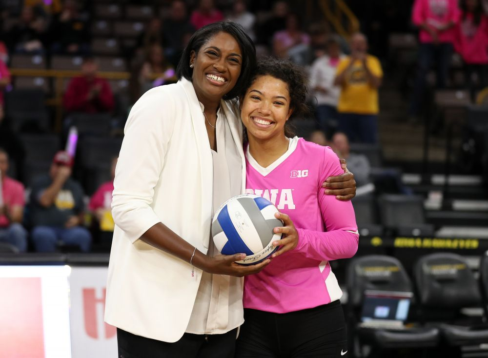 Iowa Hawkeyes head coach Vicki Brown presents setter Brie Orr (7) a ceremonial ball for her 300th assist before their game against the Michigan Wolverines Friday, October 11, 2019 at Carver-Hawkeye Arena.(Brian Ray/hawkeyesports.com)