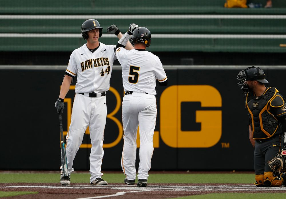 Iowa Hawkeyes catcher Tyler Cropley (5) celebrates with outfielder Robert Neustrom (44) after hitting a home run against the Missouri Tigers Tuesday, May 1, 2018 at Duane Banks Field. (Brian Ray/hawkeyesports.com)