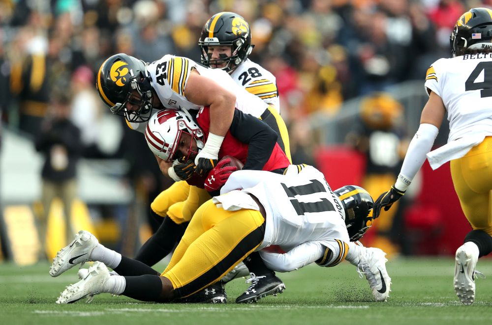 Iowa Hawkeyes linebacker Dillon Doyle (43) and defensive back Michael Ojemudia (11) against the Wisconsin Badgers Saturday, November 9, 2019 at Camp Randall Stadium in Madison, Wisc. (Brian Ray/hawkeyesports.com)