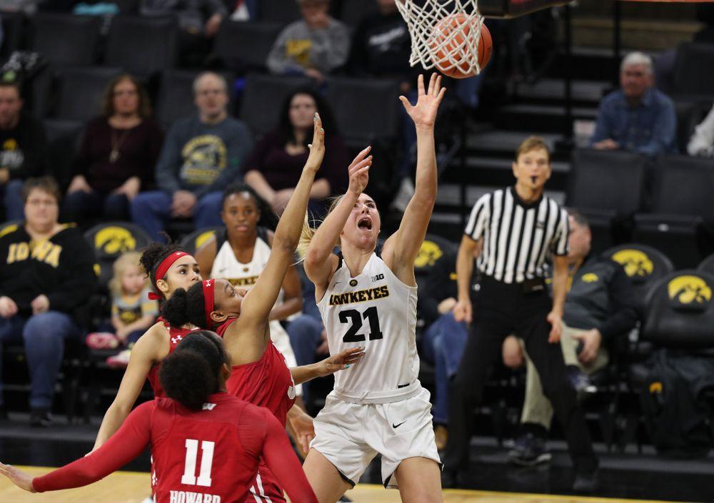 Iowa Hawkeyes forward Hannah Stewart (21) against the Wisconsin Badgers Monday, January 7, 2019 at Carver-Hawkeye Arena.  (Brian Ray/hawkeyesports.com)