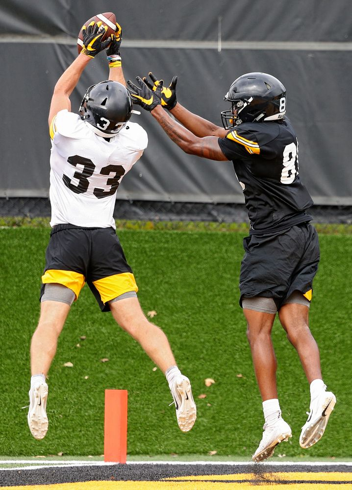 Iowa Hawkeyes defensive back Riley Moss (33) intercepts a pass intended for wide receiver Desmond Hutson (81) during Fall Camp Practice No. 15 at the Hansen Football Performance Center in Iowa City on Monday, Aug 19, 2019. (Stephen Mally/hawkeyesports.com)