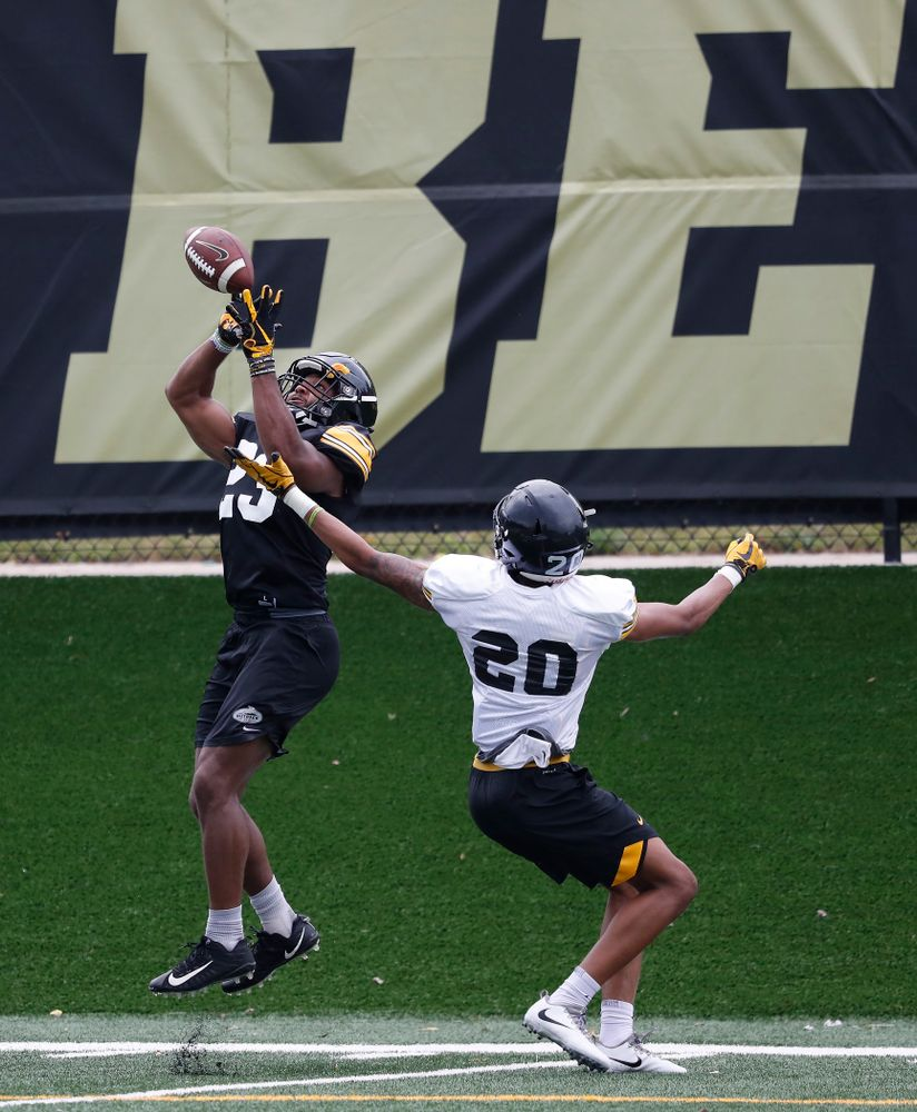 Iowa Hawkeyes wide receiver Dominique Dafney (23) and defensive back Julius Brents (20) during practice No. 4 of Fall Camp Monday, August 6, 2018 at the Hansen Football Performance Center. (Brian Ray/hawkeyesports.com)